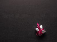 Gift box on a blank chalkboard