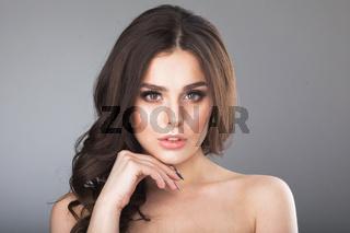 Beautiful young girl touching her skin