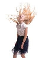 Pretty teenaged blonde with flying hairs cropped isolated shot