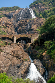 The Dudhsagar Falls of the  Mandovi River in the Indian state of Goa with railway bridge crossing it.