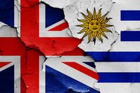 flags of UK and Uruguay painted on cracked wall