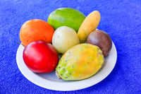 Colorful special portuguese fruits on dish