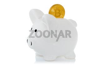 Piggy bank with Bitcoin coin
