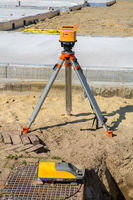 Construction site with laser and surveying equipment