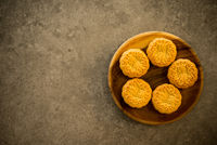 Moon cakes on dark background with copy space