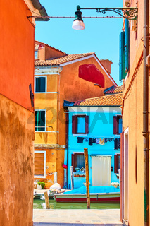 Scenic view of houses by canal in Burano