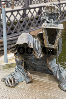 The Black Ghost bronzed sculpture (designed by Svajunas Jurkus and Sergejus Plotnikovas). Danes river quay. Klaipeda Old Town residential district. Lithuania