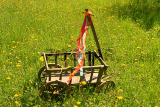 A handcart with colorful ribbons