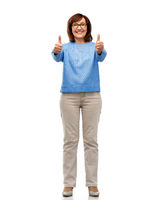 happy smiling senior woman showing thumbs up