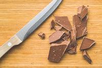 Crushed dark chocolate.