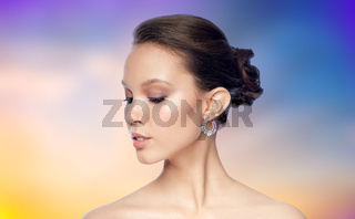 close up of beautiful woman face with earring