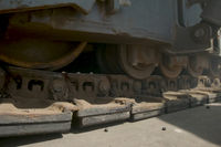 Movement of a caterpillar tractor. Equipment for paving of asphalt. Construction of roads