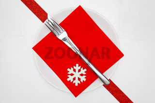 White plate and red Christmas decoration