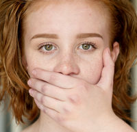 Girl covers her mouth