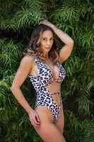 Lovely Brunette Bikini Model Posing Outdoors In A Urban Environment