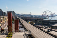 Views from the back of the Pike Place Market on the Ferris wheel and freeway next to Elliott Bay in Seattle.