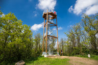 Spiral staircase of lookout tower, wooden construction with metal steps. Observation tower, place from which to keep watch or view landscape. Bedrichova vyhlidka - Czech republic.