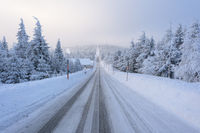 Road from the mountain in the morning in winter
