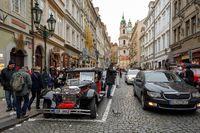 Famous historic car Praga in Prague street