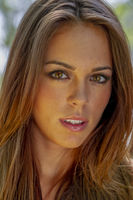 Headshot Of A Beautiful Brunette Model Poses In An Outdoor Environment