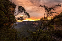Sunset over the cliffs and valleys of Blue Mountains