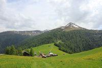 Idyllic village Obermutten in early summer and Muttener Horn, mountain in Switzerland.