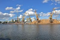 Old industrial crane in the river port