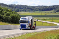 Road Landscape with Oversize Load Transport