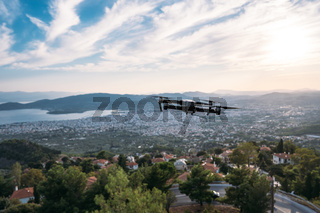View from a high mountain quadrocopter the coastal city in the background