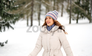 happy smiling woman outdoors in winter forest