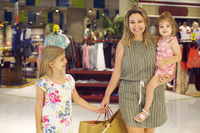 Mother and daughters walking with shopping bags