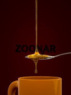 a spoon full of golden honey over a tea mug