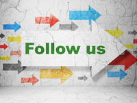 Social media concept: arrow with Follow us on grunge wall background