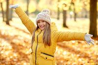 happy girl at autumn park