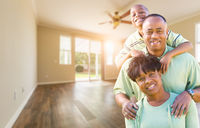 Happy African American Young Family In Empty Room of House