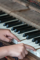 Little girl playing on the piano