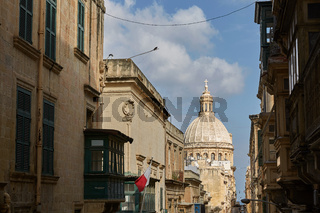 Traditional narrow street and church in Valletta in Malta