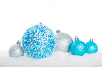 Christmas balls on snow isolated