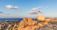 Lighthouse on granite rock formations at Capo Testa, Sardinia, Italy.