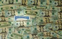 Social security card among thousands of US dollar bills