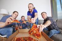 Friends taking pizza