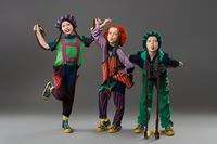 Children in colorful costumes grimacing looking at camera
