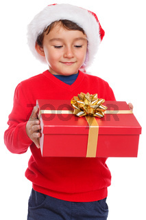 Kind Geschenk Weihnachtsgeschenk Weihnachten Weihnachtsmann Nikolaus Überraschung freigestellt isoliert Freisteller