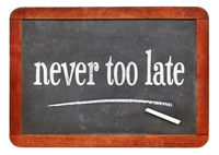 never too late text on blackboard