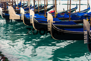 Rows of traditional wooden gondolas
