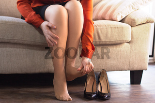 Woman taking off her shoes.