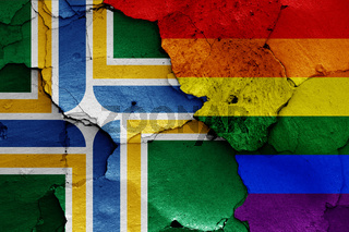 flags of Portland and LGBT painted on cracked wall