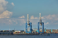 Port crane loads a container on Pier for transportation of import export and business logistic in Copenhagen Denmark