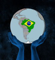 Brazil on political globe in hands
