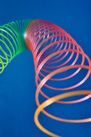 Close up curve of rainbow plastic toy spiral.